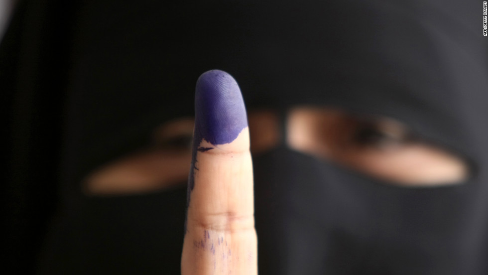 An Egyptian woman holds up an ink-stained finger after casting her ballot in Cairo on Wednesday, May 23, the first day of voting in the historic election.