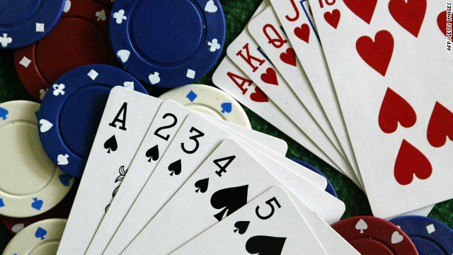 A Straight Flush (L) and a Royal Flush (R) are displayed 12 January 2005 in Miami, Florida.
