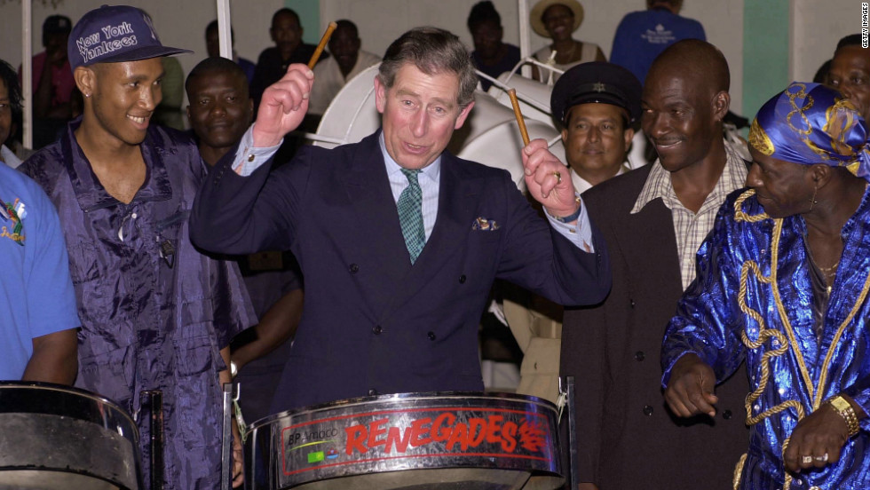 Prince Charles plays a steel drum used in a concert held at the BP Amoco Pan Yard to greet his arrival in Port of Spain, Trinidad, on February 21, 2000.