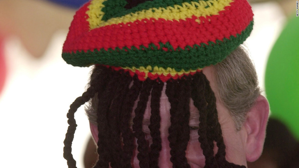 Prince Charles wears a hat known as a Rastafarian tam presented to him by Rita Marley, Bob Marley's wife, on February 29, 2000, in Trench Town, Jamaica.