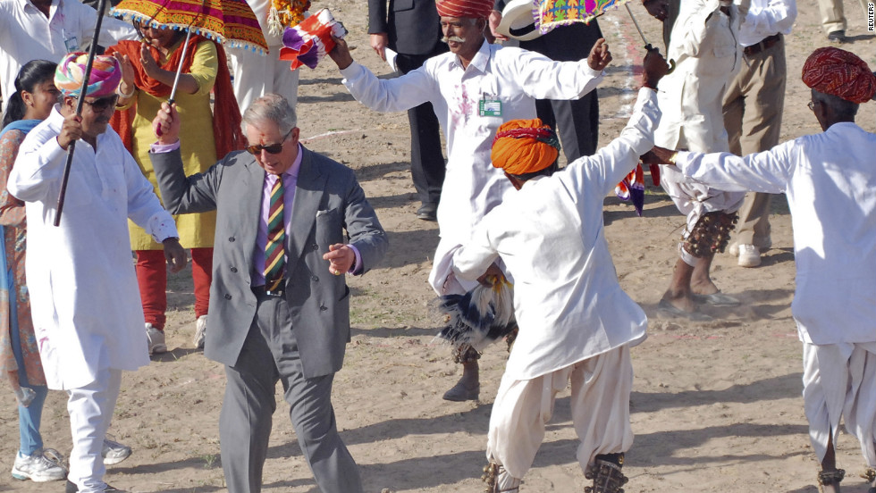 Prince Charles dances with villagers in Rajasthan, India, on October 5, 2010.