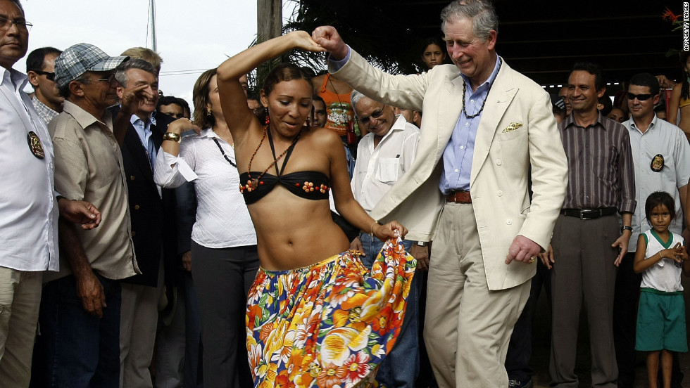 Prince Charles dances caribo with a local dancer during his visit to Maguari Community near Santarem, Brazil, on March 14, 2009.