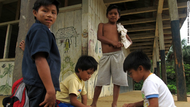 Sarayaku children in Ecuador may lose land to oil interests.