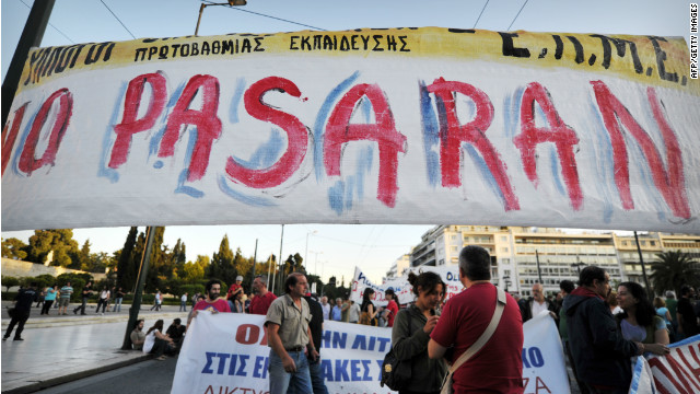 Anti-austerity protesters gather behind a banner in central Athens on May 22, 2012.