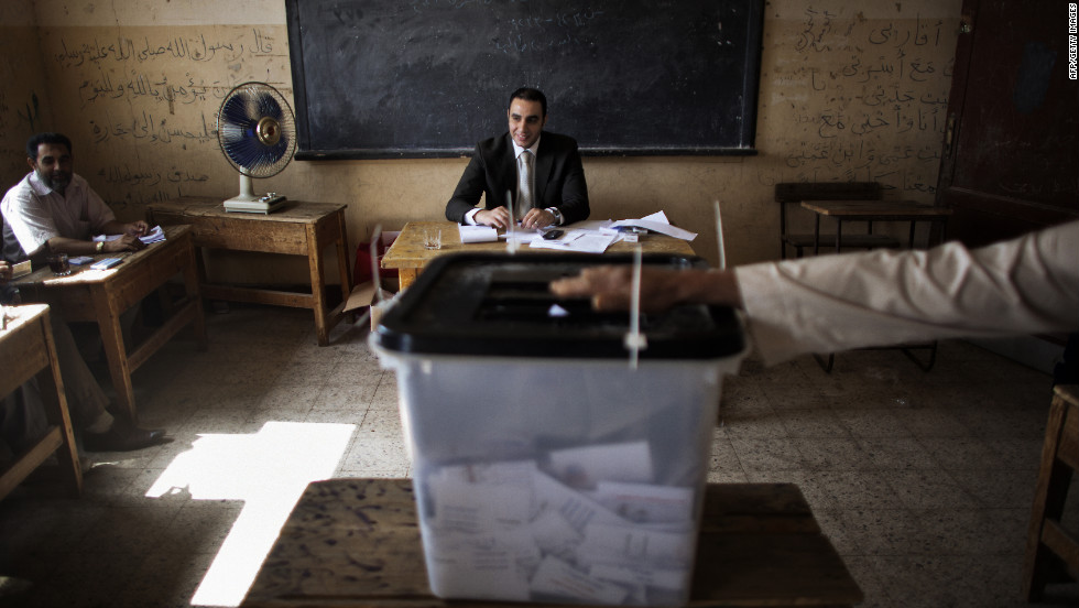 Electoral officials monitor voting in Namul, a village north of Cairo, on Thursday, May 24, the second and final day of voting in Egypt's historic presidential election. Egypt is holding its first presidential election since last year's toppling of Hosni Mubarak, part of the wave of Arab Spring uprisings.