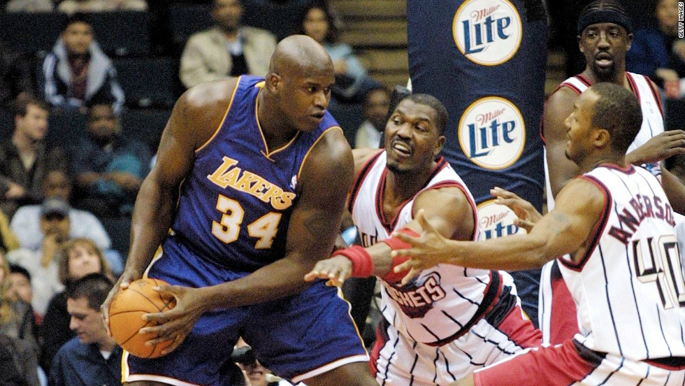 "It maintained the tradition of America's ""Dream Team."" The 1996 lineup included Houston Rockets' Hakeem Olajuwon (center) and Shaquille O'Neal of the Lakers."