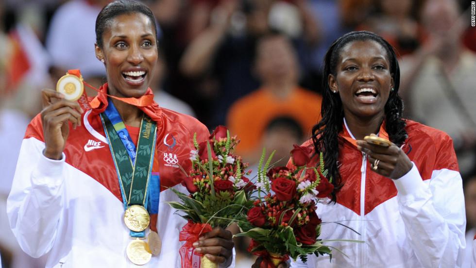 Lisa Leslie, left, proudly displays the four gold medals she won after collecting the last at the 2008 Beijing Olympics.