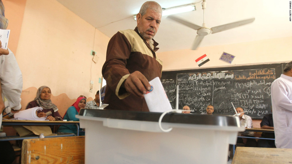 An Egyptian man drops off his ballot at a polling station Thursday in Cairo. The voting marks the first time Egypt has held a presidential election in which the results aren't known beforehand.
