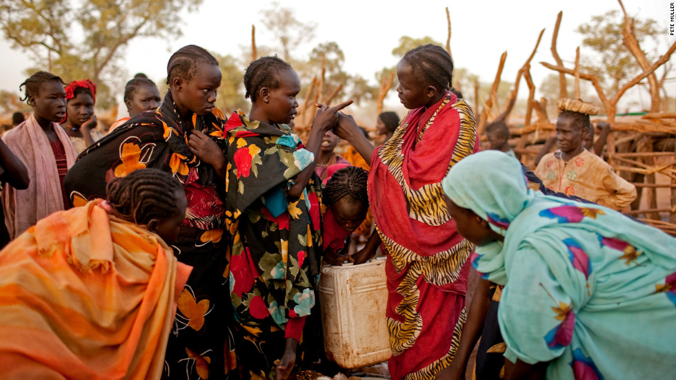 Two Nuba women argue at a water point in the Yida refugee camp, South Sudan, in April 2012. Water is in extremely short supply in the camp, which has daily temperatures of more than 115 degrees. Women and children often stand in line for up to 10 hours to fill one jerry can.