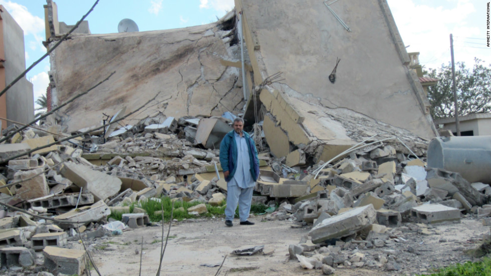 "Mustafa Naji al-Morabit by the ruins of his home in Zlitan, Libya, in February 2012. It was struck on August 4, 2011by a NATO airstrike. He told Amnesty International: ""My family has been destroyed; I lost my two little boys and my wife, Ibtisam, who was also my best friend. It is really difficult to go on, to get up every day and face life; I tell myself that I must find the strength for my son, the only child I have left."""