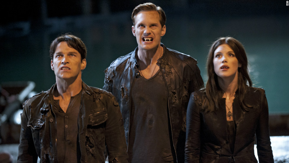 The fifth season premiere takes us back to Bon Temps, where Sookie's dealing with the aftermath of Tara being shot, and Eric (Alexander Skarsgard, center) and Bill (Stephen Moyer, left) receive a visit from the Vampire Authority. Lucy Griffiths also stars.