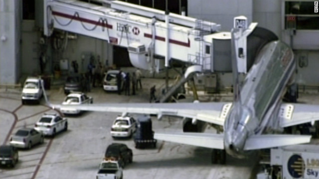 Officers in Miami detained a passenger Friday after he caused a disturbance on an American Airlines flight.