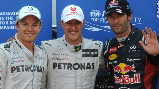 Mark Webber (right) with Mercedes pair Nico Rosberg and seven-time champion Michael Schumacher (center).