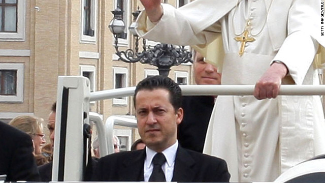 "Paolo Gabriele rides in the ""Popemobile"" with Pope Benedict XVI in St. Peter's Square in March 2011."