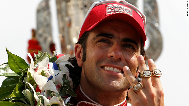 Dario Franchitti celebrates winning this third Indy 500 on Sunday.