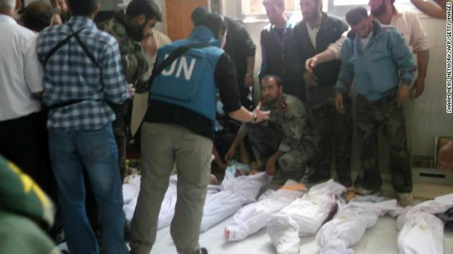 "handout picture released by the Syrian opposition's Shaam News Network shows UN observers at a hospital morgue before their burial in the central Syrian town of Houla on May 26, 2012. The head of a UN mission warned of ""civil war"" in Syria after his observers counted more than 92 bodies, 32 of them children, in Houla following reports of a massacre there. AFP PHOTO / SHAAM NEWSSHAAM NEWS/AFP/GettyImages"
