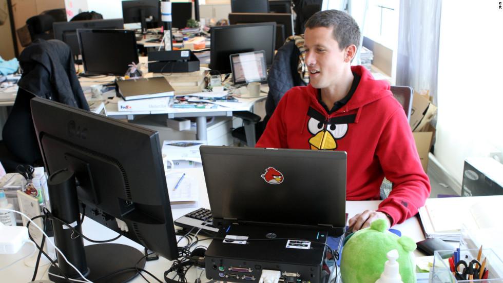 "A Rovio employee wears an ""Angry Birds"" sweatshirt as he works."