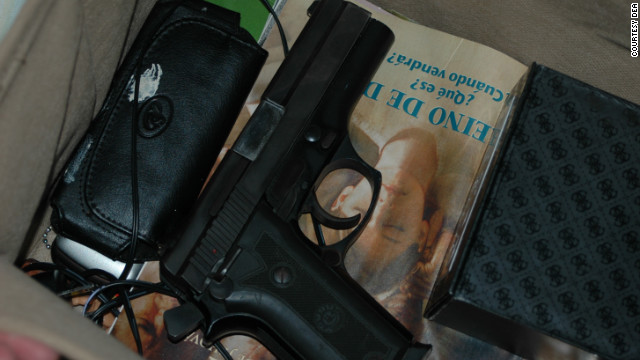 To agents' dismay, there was also a loaded handgun -- with its hammer cocked -- found during the search of the trailer.