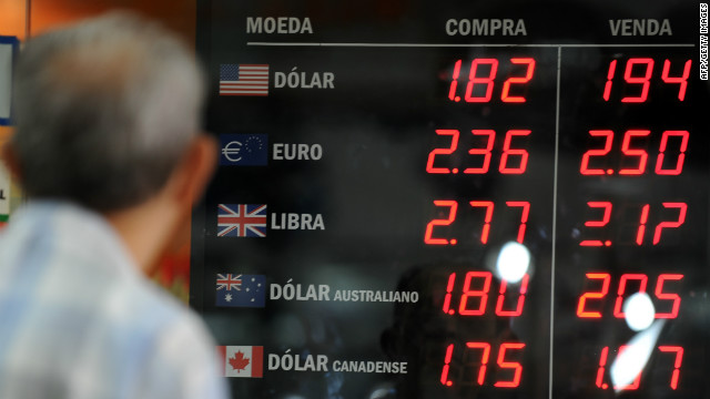 A man watches the foreign currencies exchange rate at a bureau de change in Rio de Janeiro, Brazil, on January 5, 2011.