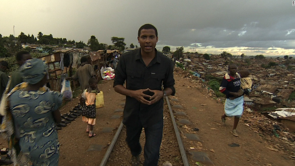 CNN's Errol Barnett walks the train tracks that run through the middle of Kibera, one of Africa's largest slums.