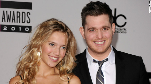 Singer Michael Buble and model Luisana Loreley Lopilato de la Torre arrive on the red carpet for the 2010 American Music Awards at the Nokia Theatre in Los Angeles on November 21, 2010