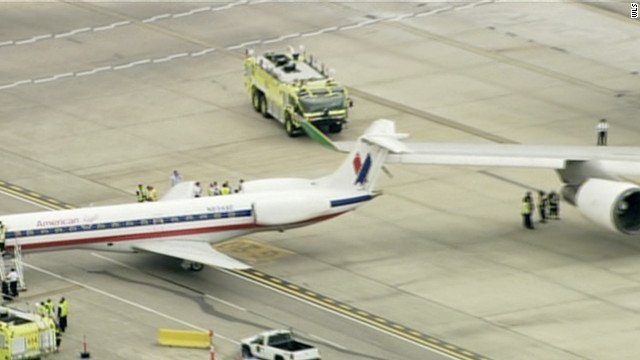 A Boeing 747 clipped the tail of a commuter plane carrying passengers yesterday at O'Hare airport in Chicago Tuesday.