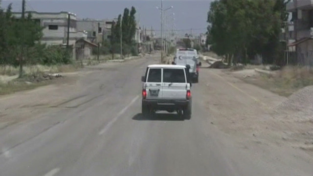 itn pkg thomson getting into houla syria_00000410