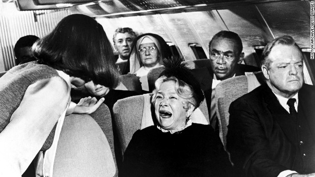 "In the 1970 movie ""Airport,"" a flight attendant tries to calm a hysterical passenger (played by actress Helen Hayes)."