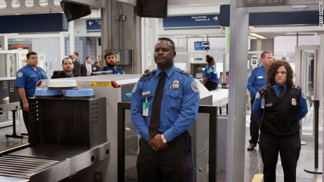TSA officers staff a checkpoint at O'Hare International Airport in Chicago.