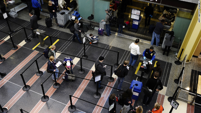 Travelers go through a TSA checkpoint at Reagan National Airport in Washington.