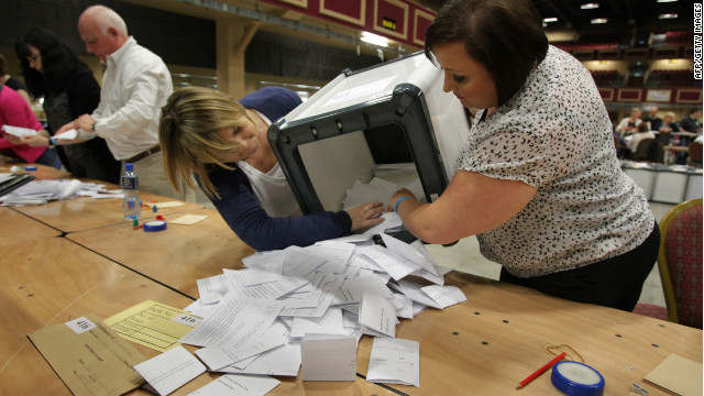 Workers begin counting votes in the fiscal treaty referendum in Dublin, Ireland, on Friday.