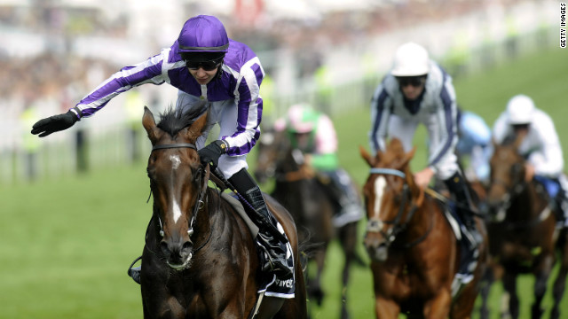 Teenage jockey Joseph O'Brien rode his father's horse Camelot to victory at Epsom Racecourse on Saturday.