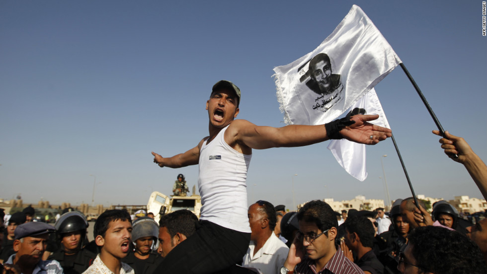 Youths protest Mubarak in Cairo.