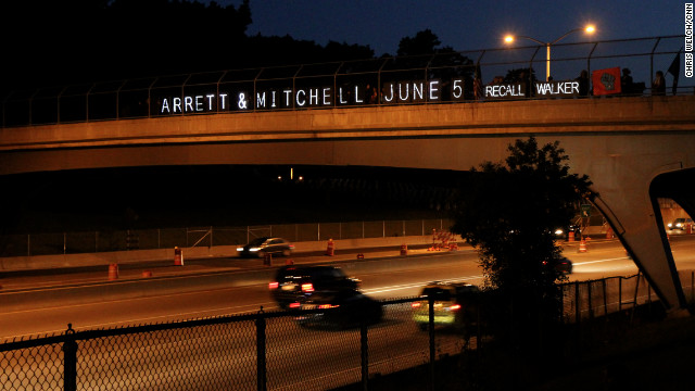 A sign on an overpass calls for the recall of Gov. Scott Walker.