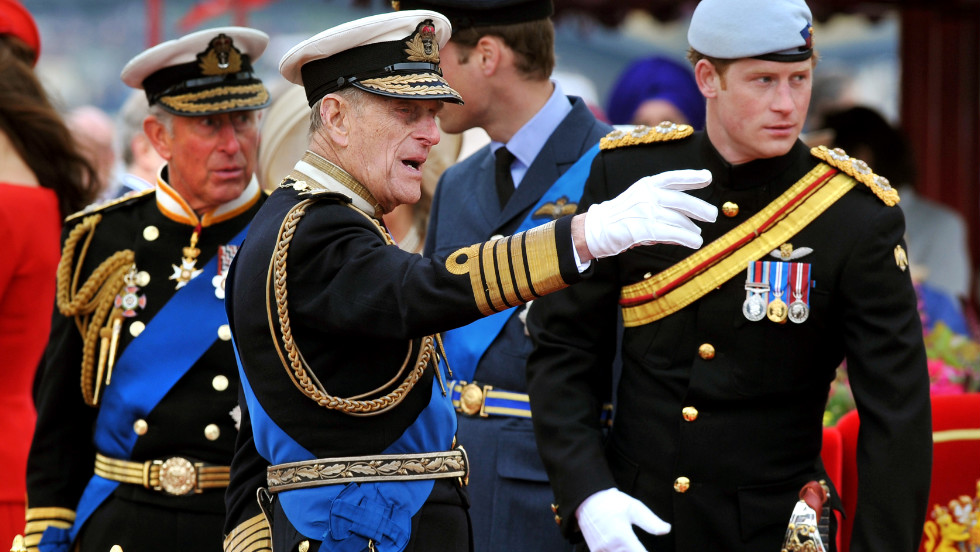 Prince Charles, left, Prince Philip, Prince William and Prince Harry talk during the Thames Diamond Jubilee Pageant on Sunday.