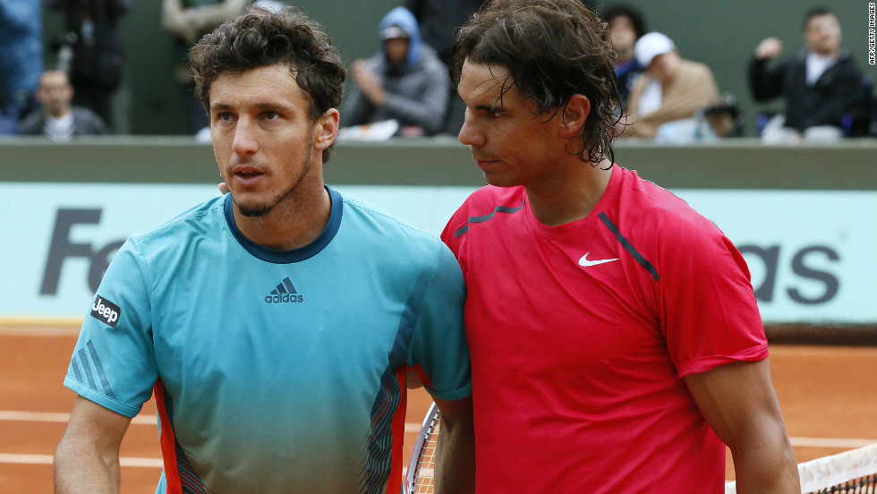 Rafael Nadal, right, was apologetic after winning 17 games in a row in his straight-sets destruction of good friend Juan Monaco in the fourth round of the French Open.