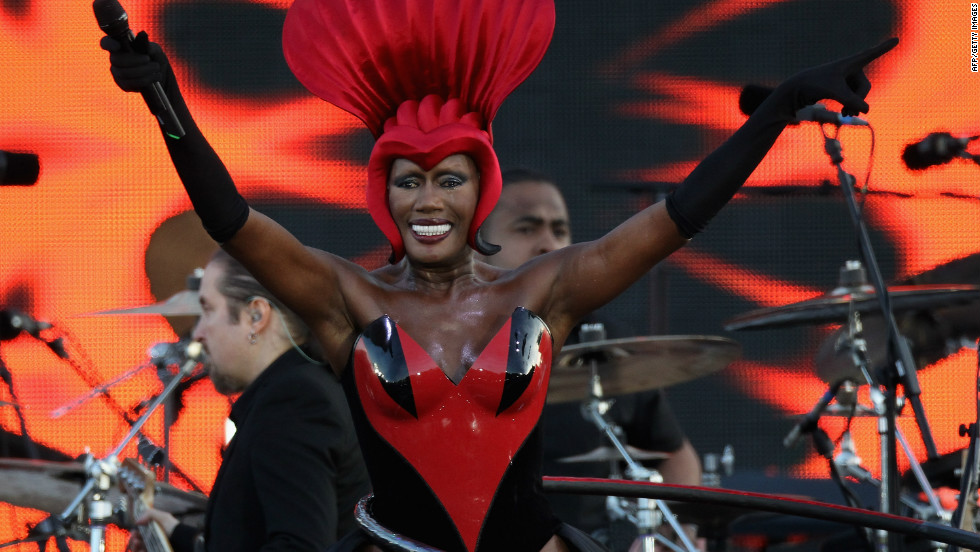"Singer Grace Jones sings her hit ""Slave to the Rhythm"" while spinning a hula hoop on her hips."