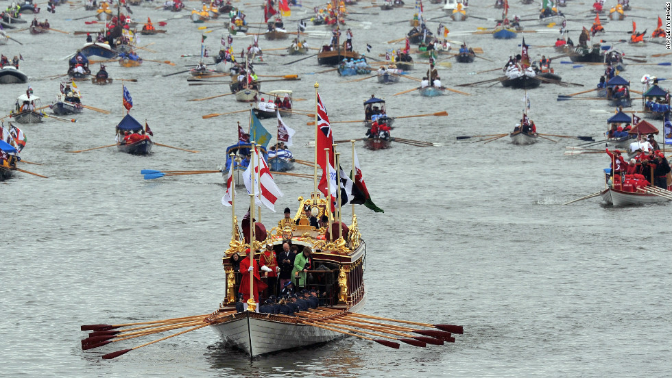 The queen's royal rowbarge, Gloriana, leads the way for the manpowered boats during the Diamond Jubilee Thames Pageant. The boat is powered by 18 oarsmen and was unique among the participating vessels because it was the only boat specially commissioned for the event.