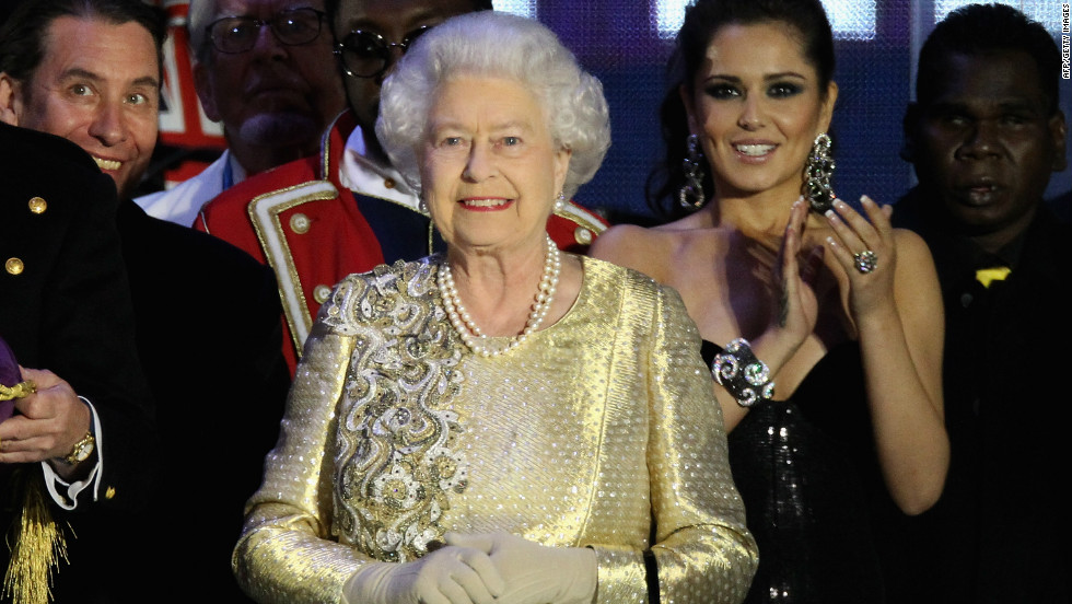 Queen Elizabeth II appears on stage at the climax of the diamond jubilee concert at Buckingham Palace in London, England.