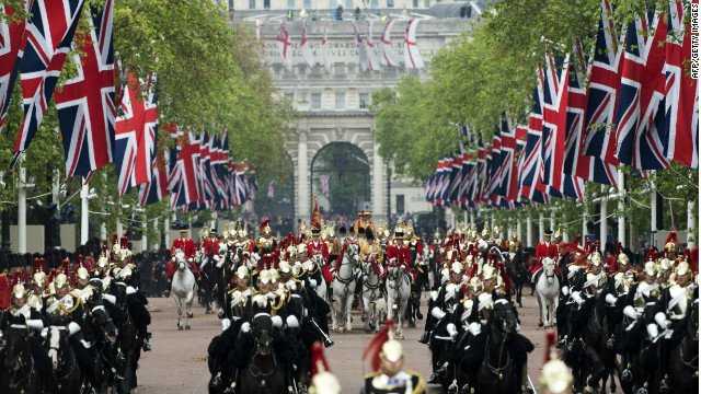 Horses ride down the Mall during the Diamond Jubilee Carriage Procession from Westminster Hall to Buckingham Palace in London on June 5, 2012.