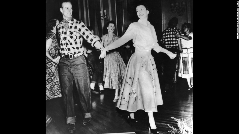 October 17, 1951: The Duke of Edinburgh dances with his wife, Princess Elizabeth, at a square dance in their honor in Ottawa, by Governor General Viscount Alexander.