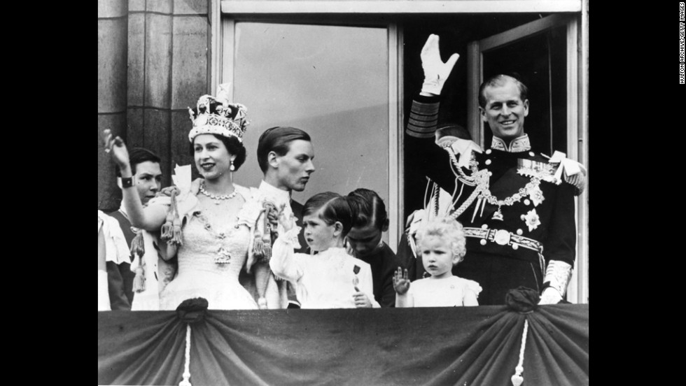 June 2, 1953: Prince Philip, Queen Elizabeth II and their children, Prince Charles and Princess Anne, wave from the balcony of Buckingham Palace after her Coronation Ceremony.