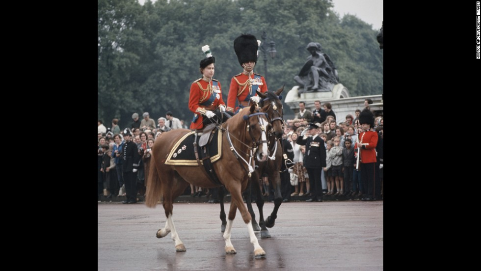 June 12, 1965: Queen Elizabeth II and Prince Philip return to Buckingham Palace after the Trooping The Colour ceremony.