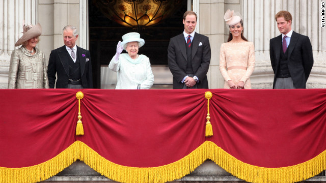 Members of the British royal family wave to the crowds from Buckingham Palace on June 5, 2012.