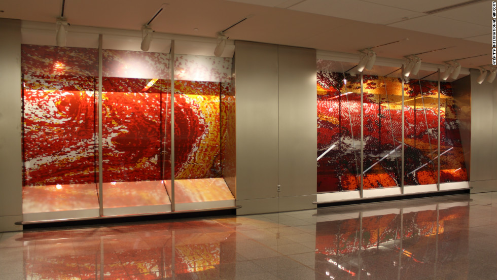 A 950 foot long installation by the artist Amy Landesberg is part of the new international terminal at Atlanta's Hartsfield-Jackson Airport. Reported to have cost $1.5 million, the mammoth artwork is one of four pieces designed to ensure the building embodies a bespoke aesthetic style.