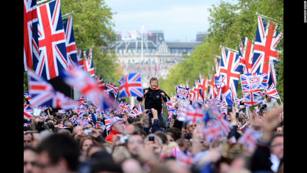 A boy waits for the start of the Queen's Diamond Jubilee Concert at Buckingham Palace.