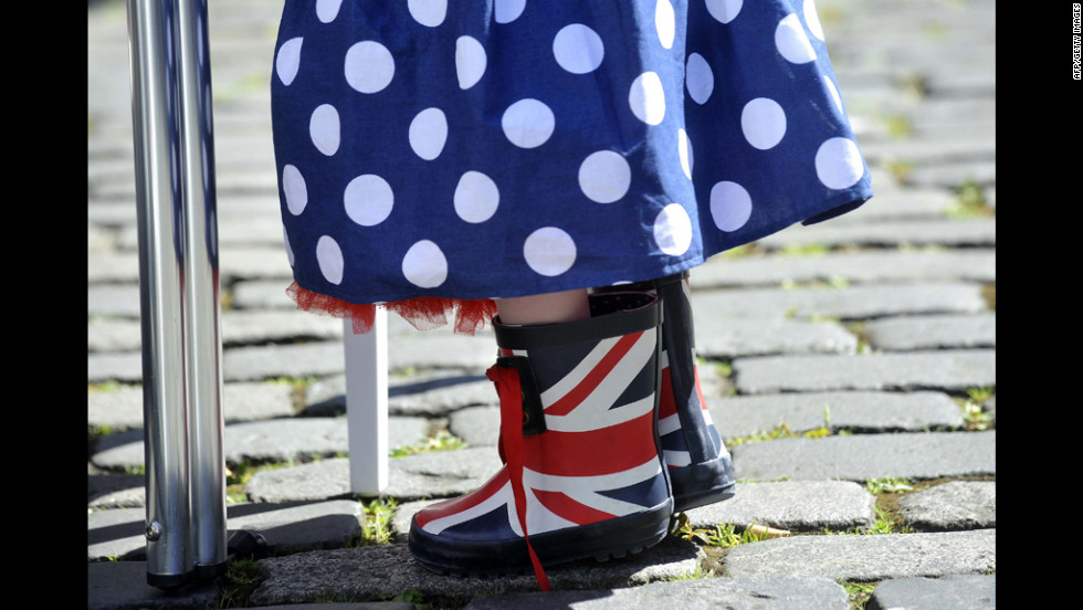 A small girl wears Union Jack boots and a skirt in Britain's colors during a street party.