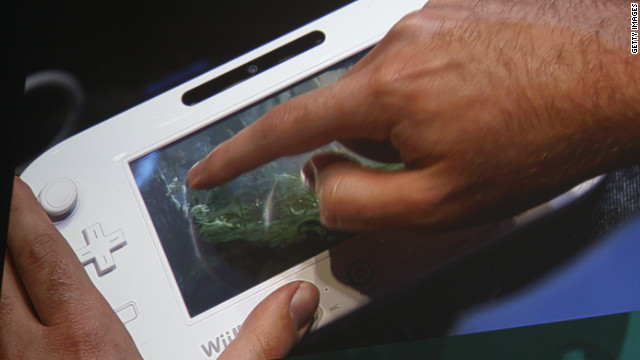 The Wii U's handheld controller displays a game during a presentation by developers Ubisoft.