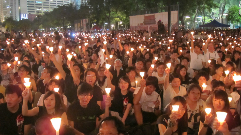 "A sea of candles accompanies rallying cries of ""Never forget June 4!"", ""Redress June 4!"", ""Persevere to the end!"" at a candlelight vigil in Hong Kong to mark 23 years since the Tiananmen Square crackdown."