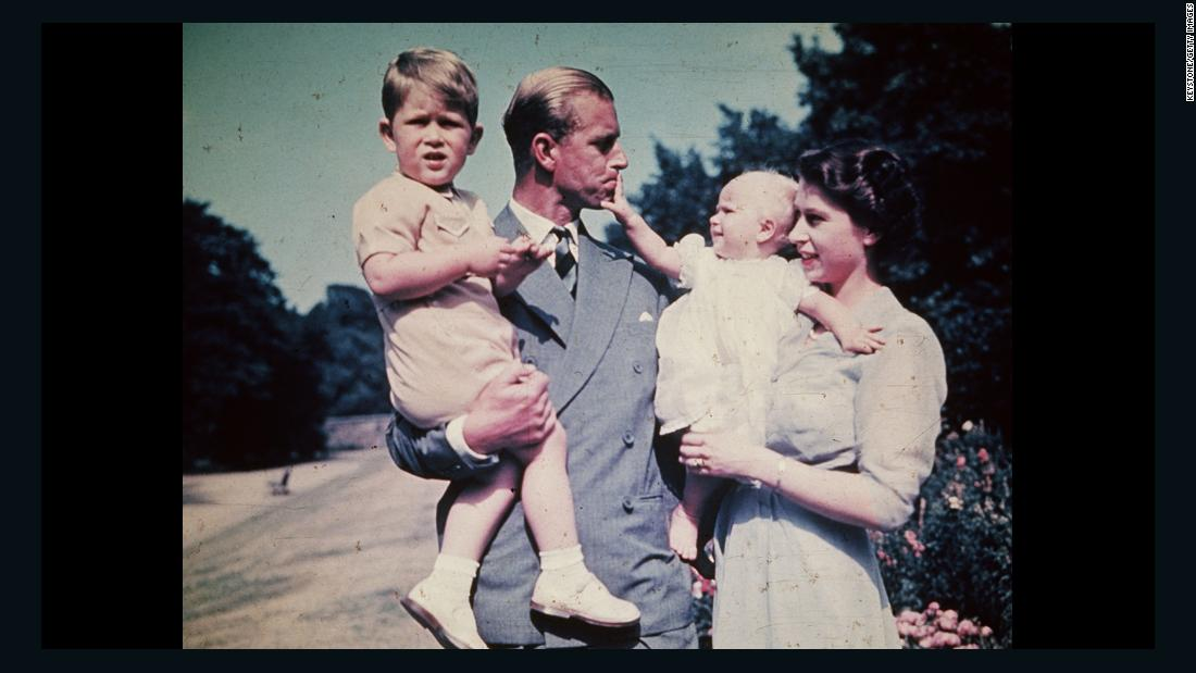 Philip and Elizabeth hold their children Prince Charles and Princess Anne in August 1951.
